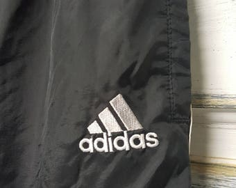 Vintage Adidas Sweatpants/Jogging pants. Black with white racing stripes