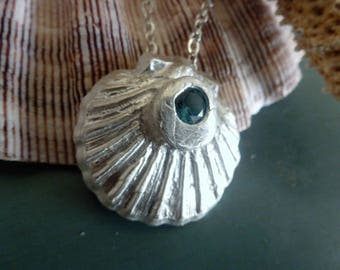 Silver Scallop Pendant Necklace showcases a weighty, highly detailed scallop shell, mounted with a London Blue Topaz. A fine silver beauty!