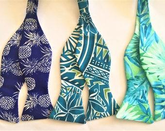 Blue Hawaiian Bow Ties.  Sold Individually: Royal Pineapples,Teal Tribal Tattoo Patterns, Teal foliage.