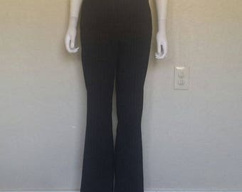 The limited stretch Black w white pinstriped flare leg pants