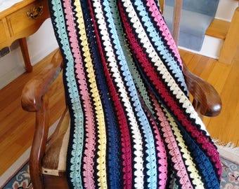 Black multicolored striped crochet afghan