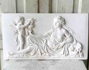 A vintage plaster plaque of an Ancient  Greek marble frieze showing Bacchus and Ariadne