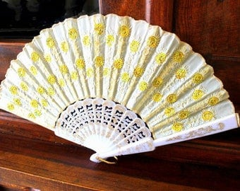 Fan,handfan  ivory, cream colored fan is decorated with golden  embroidery