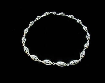 Vintage Clear Rhinestone Necklace, set in silver toned metal. Oval chain links with three clear rhinestones in each oval. Chocker length.
