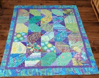 """Quilt top in all Kaffe Fassett group fabrics in greens and purples.   10 inch green squares with purple corners.  Approximately 55 x 67.5 """""""