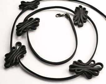 Black upcycled statement necklace made of recycled inner tube AGADIR. Vegan black jewelry. Hand made inner tube jewelry. Sustainable fashion