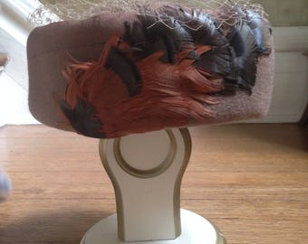 Vintage 100% wool brown pillbox hat with veil and feathers