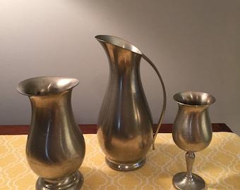 Pewter pitcher, vase and goblet