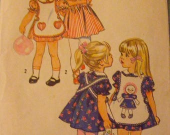 """41% OFF Toddler Dress / Apron and Transfer 1970s Uncut Simplicity Sewing Pattern 9731 Size 4 Breast 23"""""""