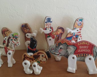 Fisher Price 902 Jr Circus set a camel, with a ringmaster, a dog, a seal, acrobats, a bear, a monkey, a clown, and an invisible parrot act