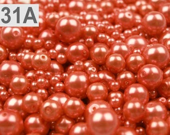 A 31-100 g of 4-12 mm glass pearl beads different sizes