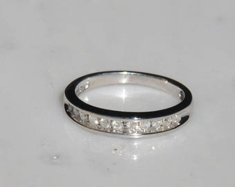 0.25 Carat 10K White Gold Band with Channel set Diamonds