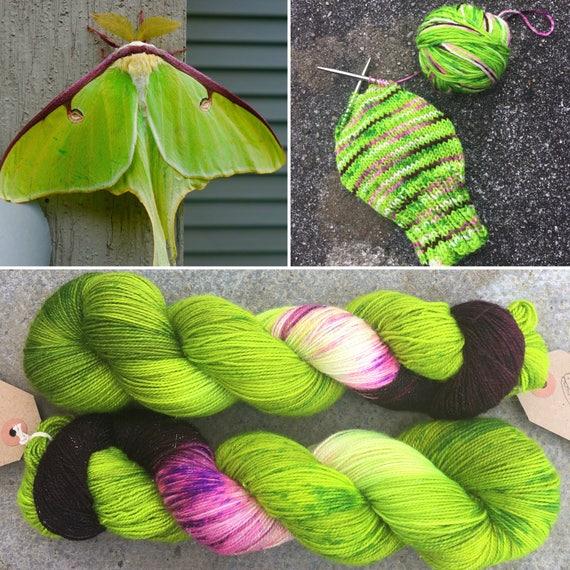 Autumn Luna Moth, green purple merino nylon UV reactive speckled sparkle sock yarn