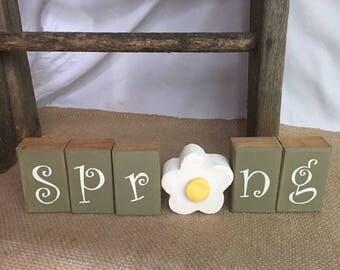 Handmade spring wooden blocks with flower