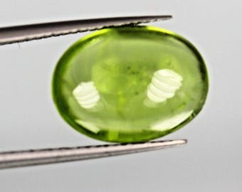 5.10ct top green color,Oval cut peridot Cabochon From Pakistan