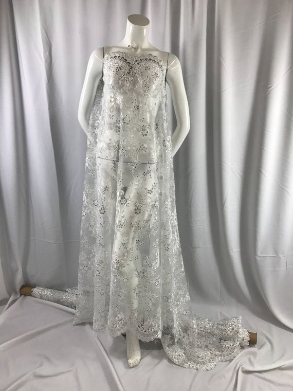 White corded french design embroider with sequins on a for French lace fabric for wedding dresses