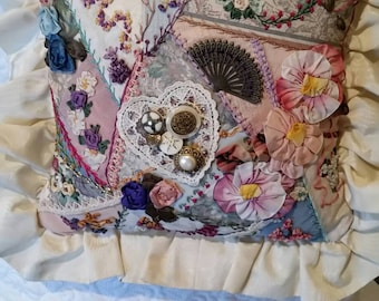 Crazy quilted pillow, decorated with silk ribbon embroidery
