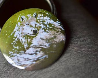 Pocket mirror with a White Wolf