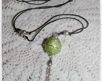 Green pregnancy's Bola Apple enclosed in a spiral silver metal