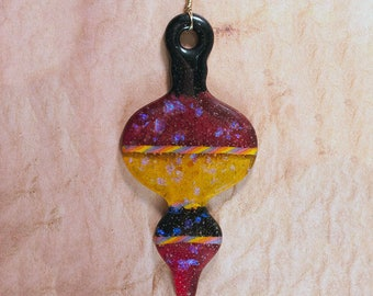 Maroon, yellow, and black fused glass ornament