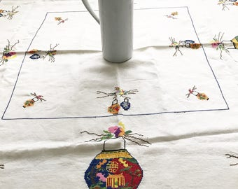 A beautiful vintage hand embroidered table cloth with unusual chinese lantern design