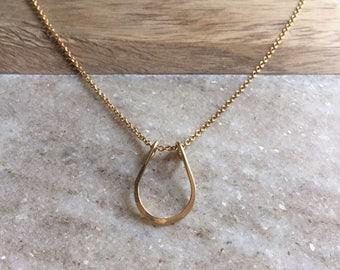 Gold horse shoe necklace