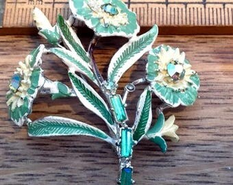 Vintage  hand painted metal brooch, featuring Leaf/Flower  design.   Beautiful cut glass green stones.
