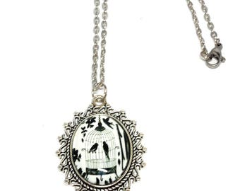 Necklace pendant bird couple in a cage