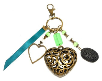 A scent! bronze bag charm, heart and green tones beads