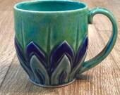 Handcarved and altered porcelain mug in Aqua, Royal blue and Light blue glazes