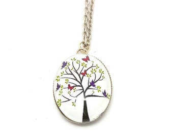 The tree has Butterfly glass cabochon necklace