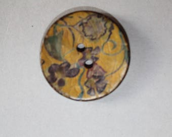 fancy patterned button leaves two holes