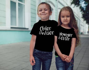 Older Wiser Younger Cuter Set of 2 Funny Toddler 2T 3T 4T Black Shirt Tee Top for Twins Cousin Sibling Brother Sister Humor Parody Novelty