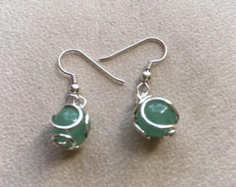 Gem bead wrapped with sterling silver dangle earring.  Fun with great movement.