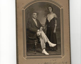 Attractive African American couple, vintage photo in folder