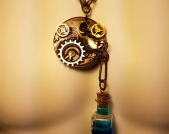Antique Gear pendent with mana potion