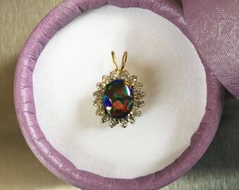 Black Opal and Diamond Pendant in 14k gold setting