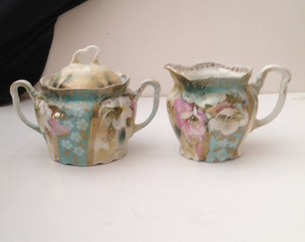 Three Crown China, Germany Pink and White Roses Creamer And Sugar Bowl with Lid; Hand Painted with Gold Scrolling & Green Maker's Mark