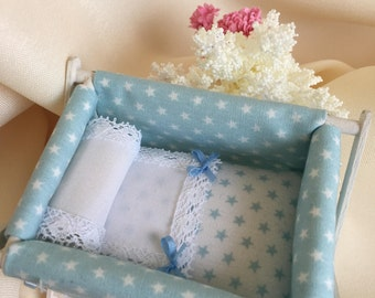 Baby crib in pink and blue