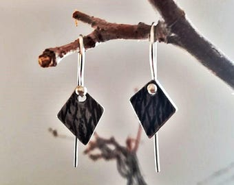 Oxidized silver earrings and BRODADO texture