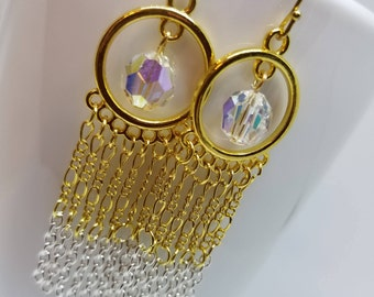 Feel Like a Glam Goddess in these Golden Circle Earrings Housing Clear Crystals With Lots of Gold and Silver Chains Dangling Downward