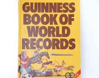 guinness book of world records | 1978 edition | edition 24 | vintage yellow book | history collectors book | coffee table books