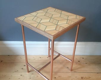 Side table in a retro industrial style with a copper pipe frame and reclaimed pine geometric cube design top