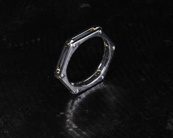 Hexagonal silver ring with brass nuts