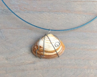 Blue necklace with wirewrapped shell