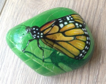 Hand painted pebble paperweight butterfly on leaf