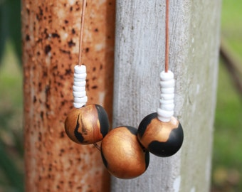 Polymer clay necklace with puka shells
