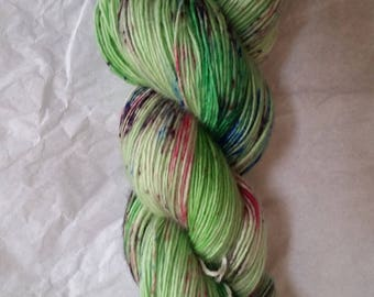 Spring Meadow - spring green with flower speckles hand dyed sock yarn on silky 100% merino single-ply - ready to ship!
