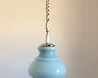 Chandelier monte/down with its blue globe in opaline from the 1970s.
