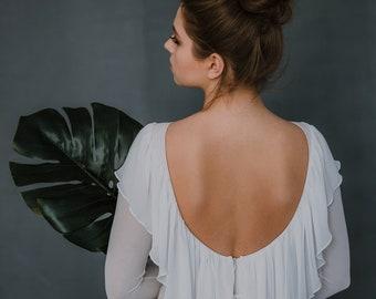 Shifon wedding dress, open back, long train. Frills on the back and shoulders